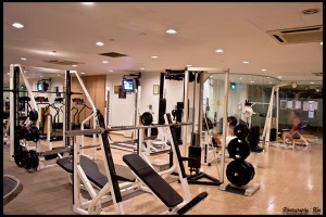Is it better to work out at the gym or at home?