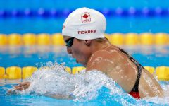 East Lake grad swims in the Olympics