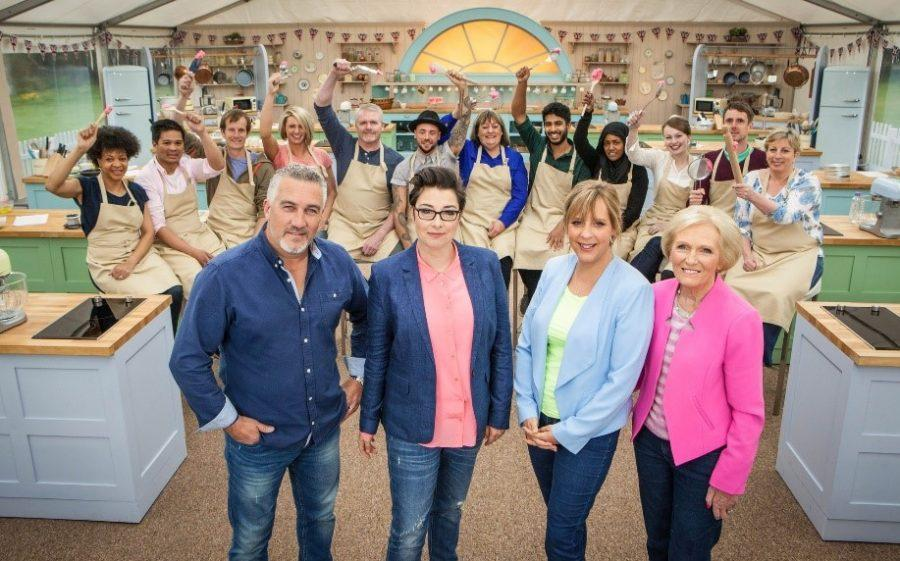 Paul%2C+Sue%2C+Mel%2C+and+Mary+are+the+hosts+and+judges+of+GBBO.+The+bakers+are+behind+them.