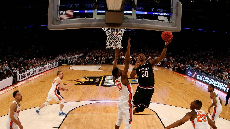 Shown here is a part of the onslaught of the Florida Gators by 7 seed South Carolina. South Carolina will play in the Final Four on Saturday.