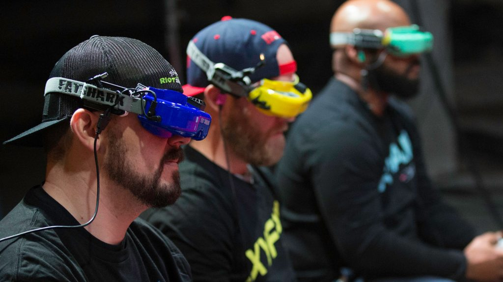 Pilots can be seen here with their FPV googles on which enables them to see the drone's path from a first person perspective.