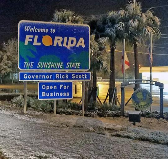 Snow covered the grassy areas of northern Escambia county last Friday.