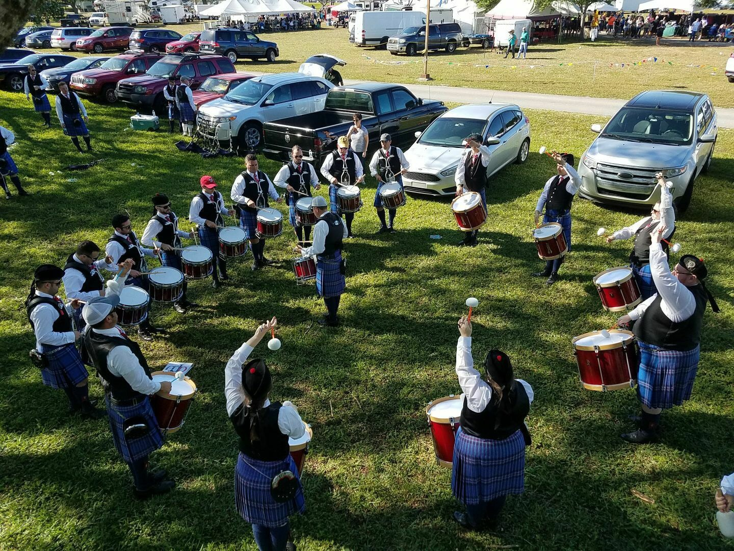 The City of Dunedin Pipe Band drum corps warming up at the Southeast Florida Highland Games.