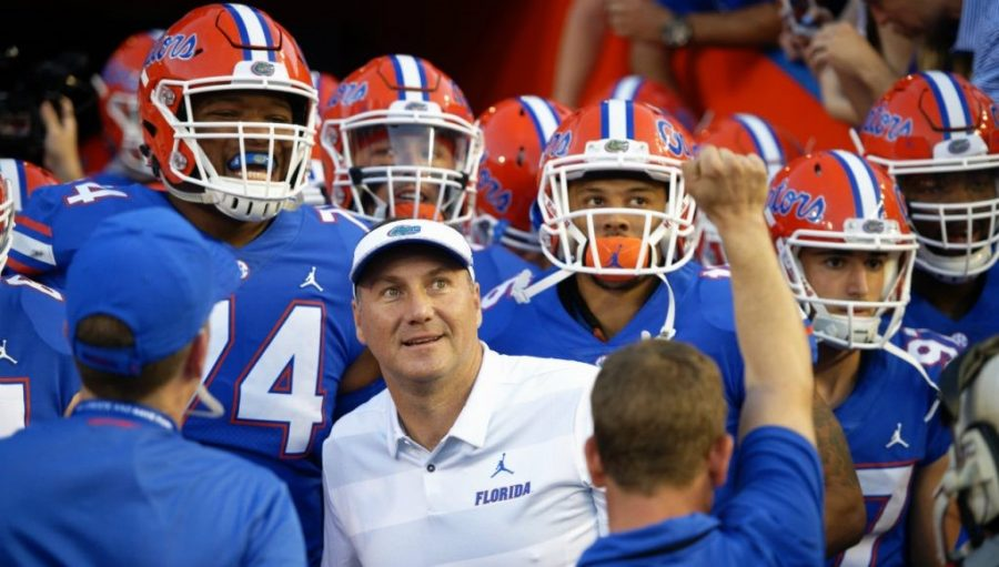Coach+Dan+Mullen+and+the+Florida+Gators+before+their+win+over+Charleston+Southern.