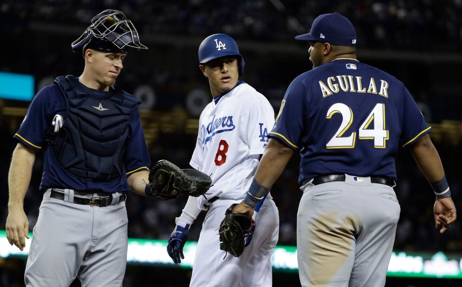1Jesus Aguilar confronts Manny Machado after being kicked in the leg in game 4. https://www.washingtonpost.com/sports/2018/10/17/christian-yelich-calls-manny-machado-dirty-player-after-game-incident-machado-says-he-is-just-playing-baseball/?noredirect=on&utm_term=.e0889d3839a0