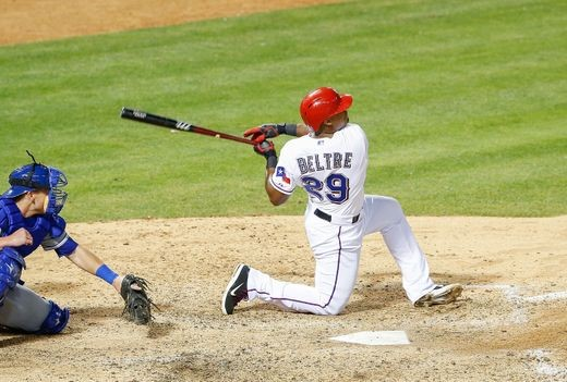 Beltre launches a big hit from his classic knee drop swing.