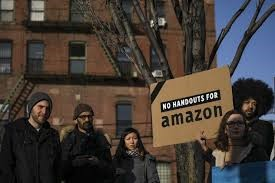 People in New York City protesting the building of Amazon's headquarters.
