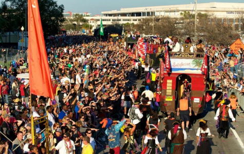 """Photo by: http://gasparillapiratefest.com/main-festival/parade/  """"A day of beads and fun"""""""