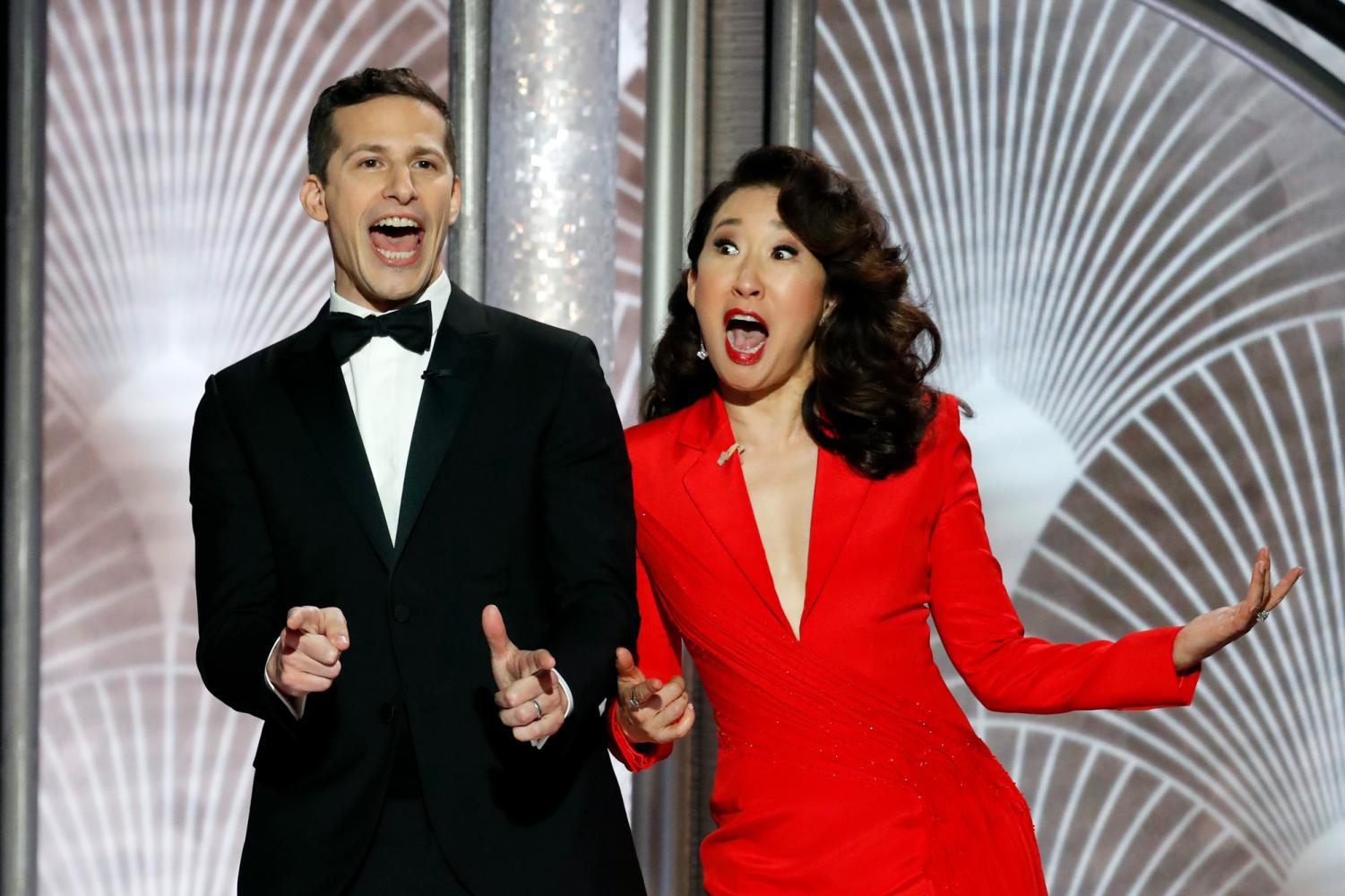 Sandra Oh and Andy Samberg having fun on stage at the 76th annual Golden Globes.