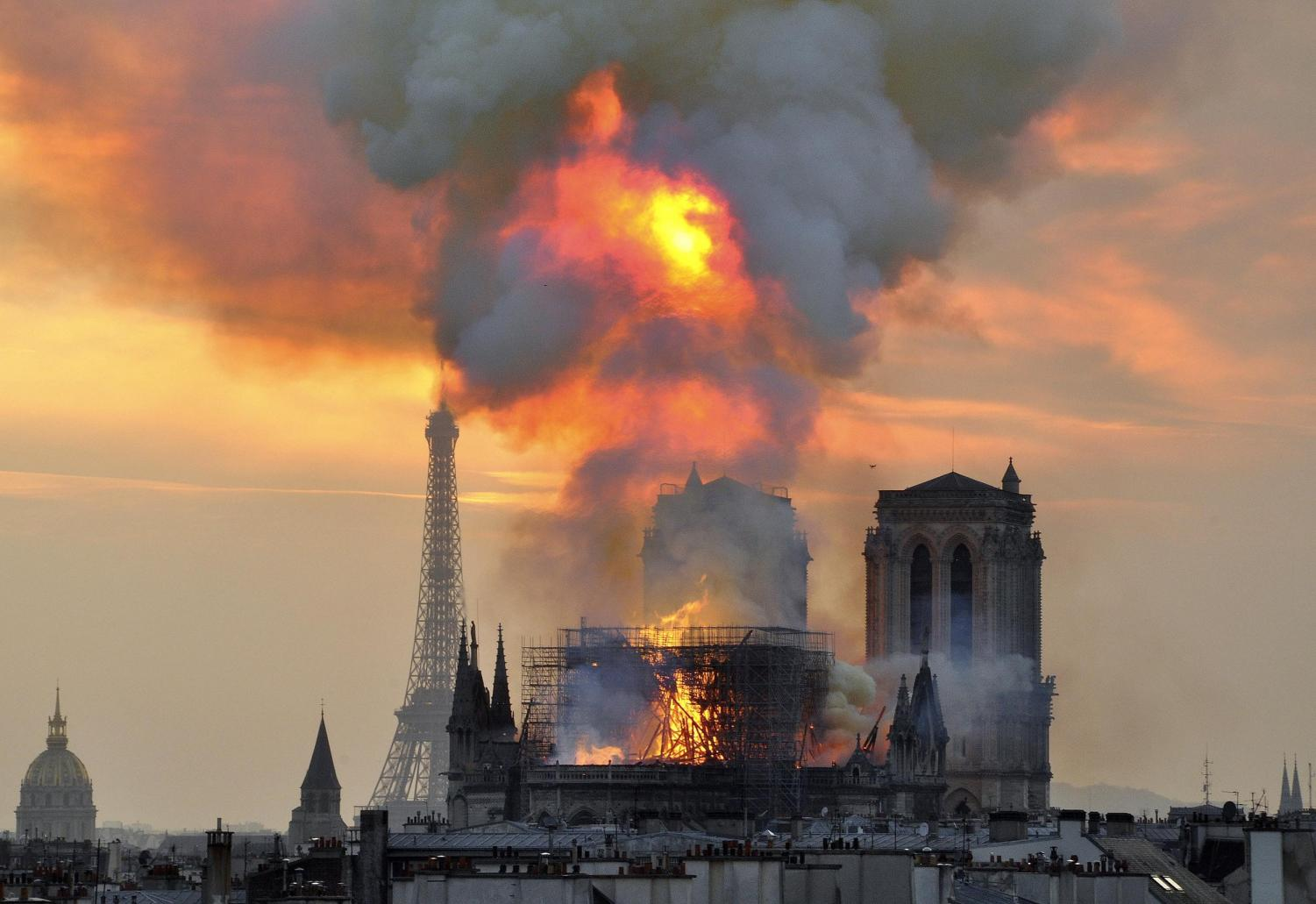 The world  looked on in horror as the iconic spire collapsed in the flames.