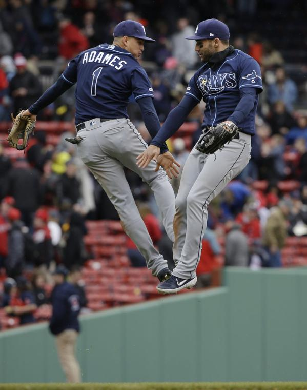 Caption: Willy Adames and Kevin Kiermaier celebrate a series sweep of the Red Sox. Photo provided by valleymorningstar.com