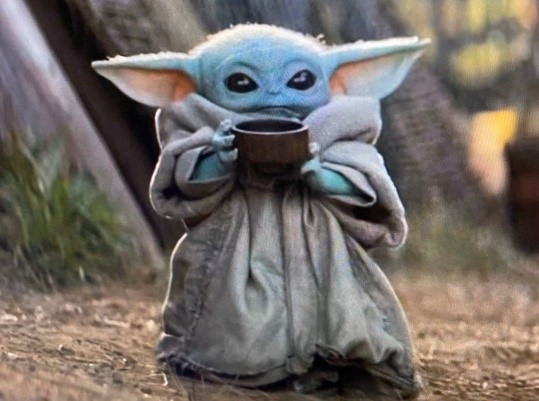 Baby Yoda chilling with his cup of soup minding his own business, and not judging others. Photo provided by themarysue.com