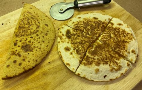 The quesadilla on the left is on a corn tortilla and the one on the right is on a flour tortilla.