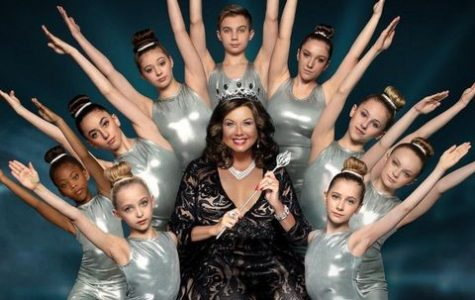 Dance Moms is a show that follows a competitive dance team called the Abby Lee Dance Company. These girls are extremely competitive and spend countless hours rehearsing, but the most entertaining part of the show is usually watching their mothers argue and get into fights. 	Throughout the show, the main focus has normally been the drama between the mothers and the dance teacher, Abby Lee Miller. Abby tends to use an extremely harsh teaching method, which often upsets the mothers and causes arguments that usually get out of hand and end up in screaming matches. Abby's harsh teaching methods are often the focal point of the show as the kids strive for Abby's approval but never seem to gain it.  The fights in this show are dramatic and over the top, making it a very entertaining show to watch. The moms often get in fights not only with Abby, but with each other as they fight over things such as who's child gets solos or other special parts in their competitions. This drama is what makes the show so entertaining and makes it a great show to binge watch. Abby's behavior is often shocking and usually the cause of this drama, as she will usually be too harsh on the kids and lash out at the moms for sticking up for them. This also causes more drama between the moms as Abby often shows blatant favoritism, normally towards Maddie and Mackenzie Zeigler. This puts a strain on the relationships between the mothers on the team and causes more drama, making the show extremely entertaining. Though a lot of the drama and fights on the show may have been faked or exaggerated, the show can still be extremely addicting to those who watch it and is one of the most iconic reality T.V. shows ever. Caption: Abby and her team from the newest season of Dance Moms.