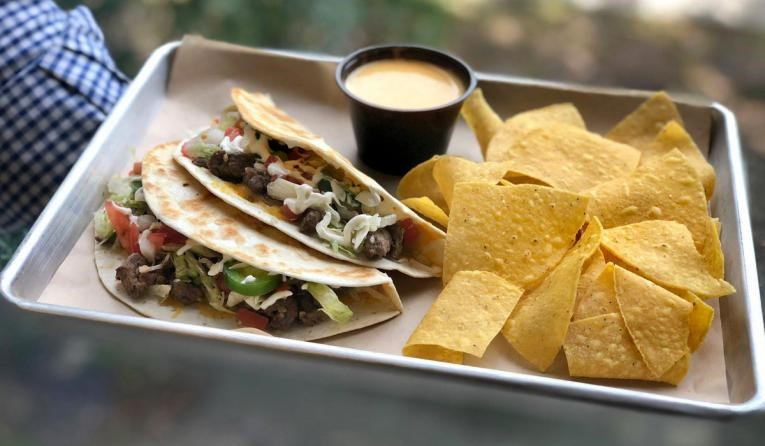 Delicious tacos that you can get at good price at Tijuana Flats or Moe's.