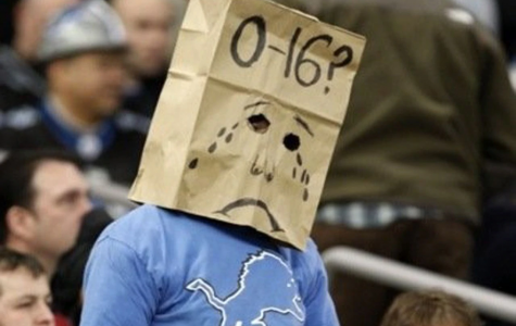 A depressed and disappointed lions fan wears a bag over his head, signifying the winless season that Lions had in 2008.