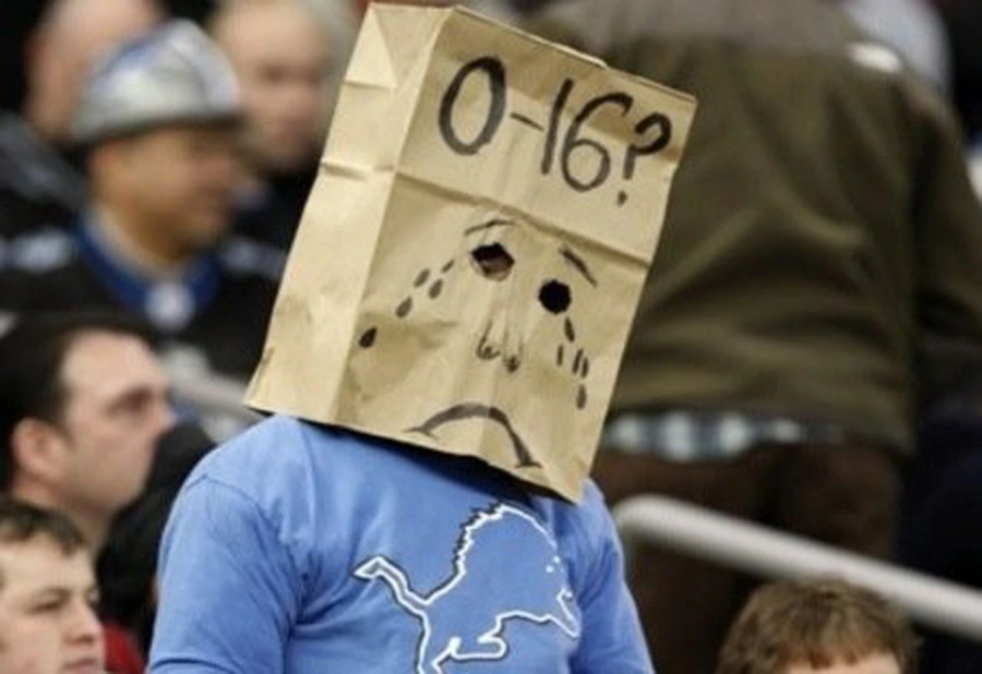 A+depressed+and+disappointed+lions+fan+wears+a+bag+over+his+head%2C+signifying+the+winless+season+that+Lions+had+in+2008.