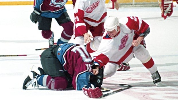 Darren+McCarty+goes+after+Claude+Lemieux+before+taking+him+to+the+boards+as+revenge+for+the+hit+on+Kris+Draper.+