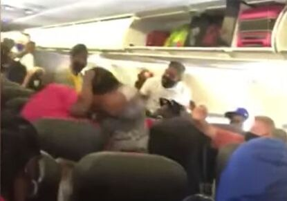 An image captured of the fight that occurred in the American Airlines flight. The flight occurred over mask wearing and it sparked a brawl. The woman refused to wear a mask and then proceeded to attack a man. She ended up being tased by police.