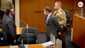 Derek Chauvin being handcuffed and taken out of the court room.